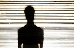 Anonymous person portrait silhouette. In black and white on patterned background Royalty Free Stock Images