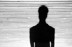 Anonymous person portrait silhouette. In black and white on patterned background Royalty Free Stock Photo