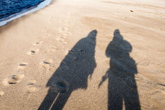 anonymous person walking on a sand at windy beach Royalty Free Stock Photography