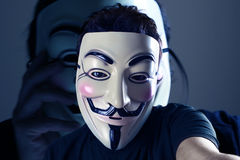 Anonymous Selfie. Anonymous taking a selfie in front of his photo Royalty Free Stock Photography