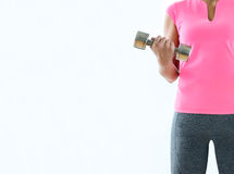 Anonymous sexy woman training with dumbbells, white background Royalty Free Stock Photo
