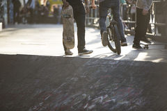 Anonymous skaters and bike riders Royalty Free Stock Images