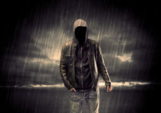 Anonymous terrorist in hoodie at night Stock Photography