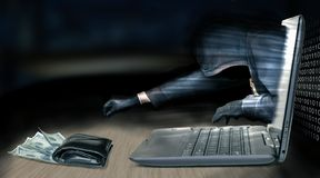Anonymous thief - hacker steals money from laptop Stock Image