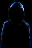 Anonymous User. With hood in black background studio shot, faceless Stock Photos