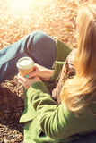 Anonymous woman enjoying takeaway coffee cup on sunny cold fall day. Autumn concept, anonymous woman enjoying takeaway coffee cup on sunny cold fall day stock photo