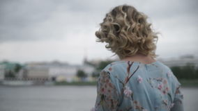 Anonymous woman in gloomy day on waterfront stock footage