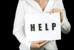 Anonymous woman with help sign Royalty Free Stock Images