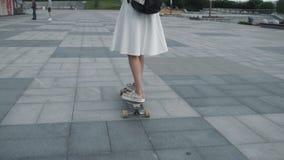 Anonymous woman on longboard stock footage