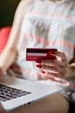 Anonymous woman using card for purchase Royalty Free Stock Images