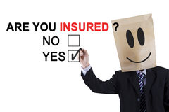 Anonymous worker approving are you insured Stock Images