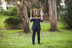 Anonynous businessman holding a frame Stock Photo