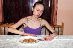 Anorexia. Skinny anorexic girl refuse to eat. Royalty Free Stock Photo