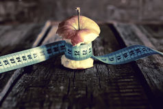 Anorexia thinness measuring apple Royalty Free Stock Photos