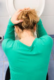 Anorexia. Woman bends over toilet to vomit royalty free stock images
