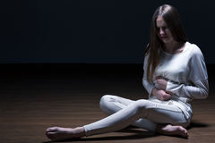 Anorexic girl with stomach ache Royalty Free Stock Photography