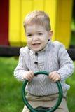 2 anos de bebê idoso no campo de jogos Imagens de Stock Royalty Free