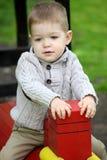 2 anos de bebê idoso no campo de jogos Fotos de Stock