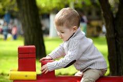 2 anos de bebê idoso no campo de jogos Imagem de Stock Royalty Free