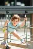 3 anos de bebê no campo de jogos Imagens de Stock Royalty Free