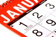 Anos de dia novos em um calendário Fotografia de Stock Royalty Free
