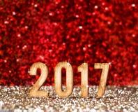 2017 anos novo feliz no vermelho e no fundo do brilho do ouro, feriado Imagens de Stock Royalty Free