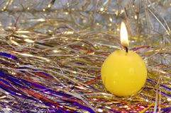 Another angle of a candle. Another angle of a yellow round burning candle stock images