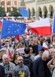 Another day in Cracow  thousands of people protest against violation the constitutional law in Poland. Defense of the triad of division of power, free election Stock Photo