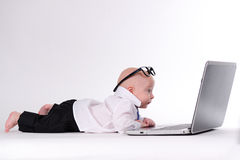 Another Day at the Office. Baby boy working on a laptop with glasses Royalty Free Stock Photo