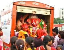 Another farwell bidding to Lord Ganesha. A colorful idol of Lord Ganesha being taken in a farewell ceremony  in the city of Mumbai , for submerging the same in a Royalty Free Stock Photography