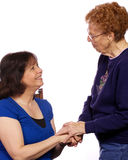 another hälsning en två kvinnor Royaltyfri Fotografi