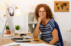 Another happy day at the office. Successful middle aged woman at her office royalty free stock images