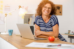 Another happy day at the office. Successful middle aged woman smiling at her office Stock Photo