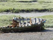 Skeleton of a sunken boat stock photo
