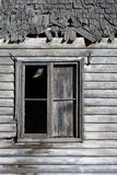 Another old window. A slightly different view of one of my favourite old windows. This time with the old wooden shingles in the shot as well royalty free stock photography