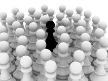 The among another's. Lonely black pawn in crowd Royalty Free Stock Photo