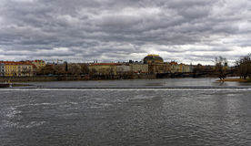 Another shot of wide river. With buildings on its side and gloomy sky Royalty Free Stock Images