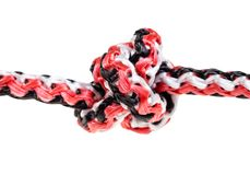 Another side of smaller Turk`s-heads knot on rope. Another side of smaller Turk`s-heads knot tied on synthetic rope cut out on white background stock photos
