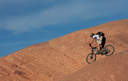 Another Slickrock Rider. A challenging descent near Moab, Utah Royalty Free Stock Photography