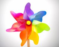 Another stationary multi-coloured  toy windmill stock image