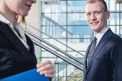 Another successful day at the office. Shot of two businesspeople in a modern interior Stock Photo