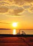 Bicycle by the lake at sunset Royalty Free Stock Photo