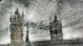 Another tower bridge. Rain reflected tower bridge in walkway royalty free stock photography