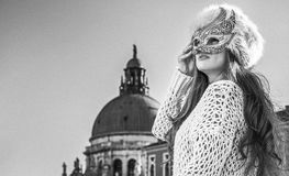 Woman looking into the distance while wearing Venetian mask Royalty Free Stock Photo