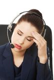 Anoyed support phone operator Stock Photo