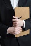 Anpassad man med clipboarden Fotografering för Bildbyråer