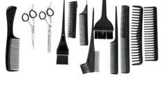Anreden des Haares mit Kämmen und Werkzeugen im Friseursalon auf weißem Draufsichtmodell des Hintergrundes Lizenzfreies Stockbild
