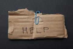Anruf der Hilfe auf alter Pappe lizenzfreie stockbilder