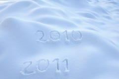 Ans 2010 et 2011 dans la neige Photos stock