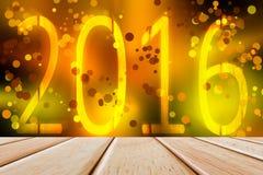 2016 ans avec le mur de scintillement de bokeh et le plancher en bois Image stock